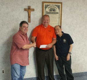 (l to r) Joe Ozoniak, GK; presents check to  Scott Milliken, Executive Director of DPD and Anthony Iovino